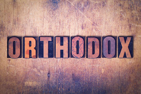 The word Orthodox  concept and theme written in vintage wooden letterpress type on a grunge background. Stok Fotoğraf