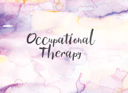 The words Occupational Therapy concept and theme written in black ink on a colorful painted watercolor background.