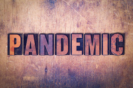 The word Pandemic concept and theme written in vintage wooden letterpress type on a grunge background.