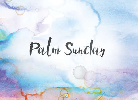 The words Palm Sunday concept and theme written in black ink on a colorful painted watercolor background.