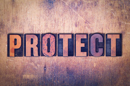 The word Protect concept and theme written in vintage wooden letterpress type on a grunge background.