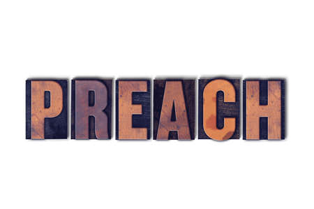 The word Preach concept and theme written in vintage wooden letterpress type on a white background.