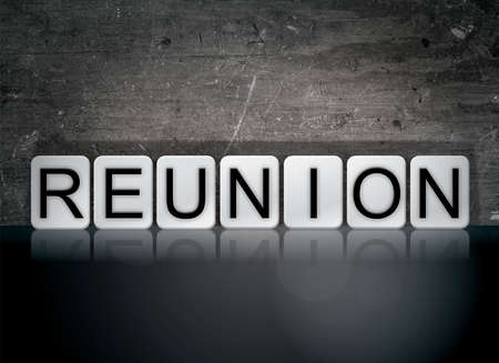 The word Reunion concept and theme written in white tiles on a dark background.