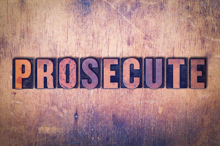 The word Prosecute concept and theme written in vintage wooden letterpress type on a grunge background. 版權商用圖片
