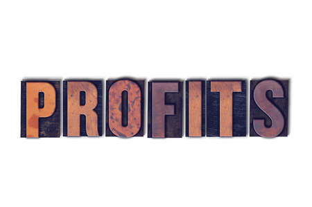 The word Profits concept and theme written in vintage wooden letterpress type on a white background.
