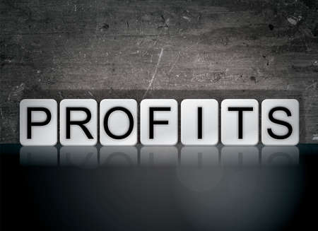 The word Profits concept and theme written in white tiles on a dark background.