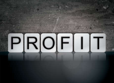 The word Profit concept and theme written in white tiles on a dark background.