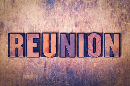 The word Reunion concept and theme written in vintage wooden letterpress type on a grunge background.