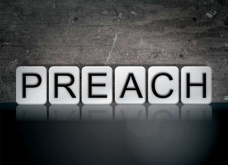 The word Preach concept and theme written in white tiles on a dark background.