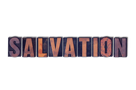 The word Salvation concept and theme written in vintage wooden letterpress type on a white background.