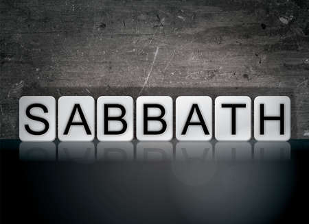 The word Sabbath concept and theme written in white tiles on a dark background.
