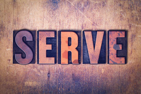 The word Serve concept and theme written in vintage wooden letterpress type on a grunge background.