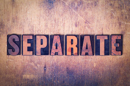 The word Separate concept and theme written in vintage wooden letterpress type on a grunge background. Фото со стока