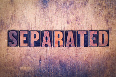 The word Separated concept and theme written in vintage wooden letterpress type on a grunge background.