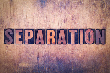 The word Separation concept and theme written in vintage wooden letterpress type on a grunge background. Фото со стока