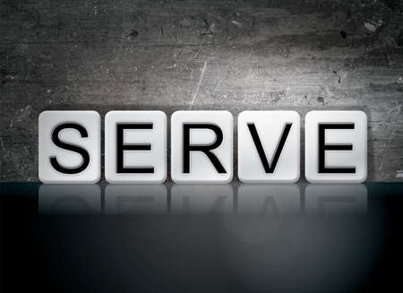 The word Serve concept and theme written in white tiles on a dark background. Foto de archivo