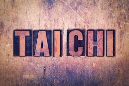 The words Tai Chi concept and theme written in vintage wooden letterpress type on a grunge background. Фото со стока - 92442283