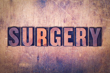 The word Surgery concept and theme written in vintage wooden letterpress type on a grunge background.