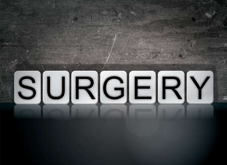 The word Surgery concept and theme written in white tiles on a dark background.