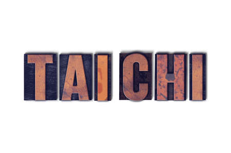 The words Tai Chi concept and theme written in vintage wooden letterpress type on a white background.
