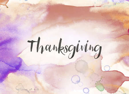 The word Thanksgiving concept and theme written in black ink on a colorful painted watercolor background.