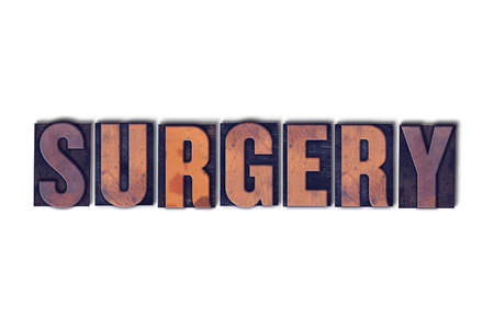 The word Surgery concept and theme written in vintage wooden letterpress type on a white background.