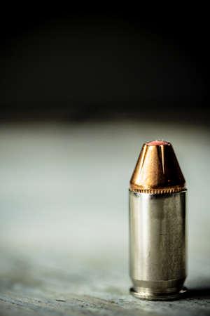 A hand gun pistol bullet.