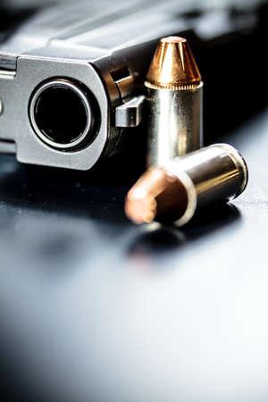 A black pistol hand gun with bullets. 写真素材