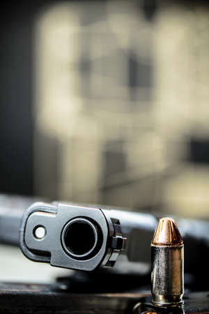 A black pistol hand gun with bullets. Stock Photo - 92737628