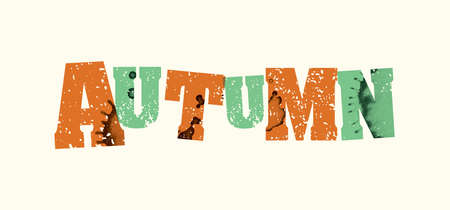The word AUTUMN concept printed in letterpress hand stamped colorful grunge paint and ink.