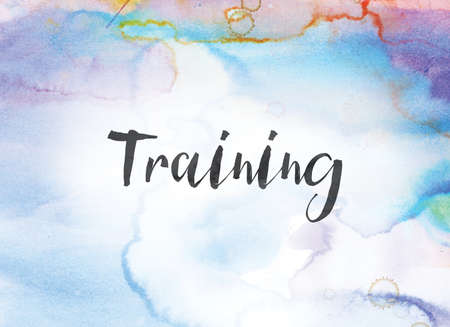 The word Training concept and theme written in black ink on a colorful painted watercolor background. Imagens