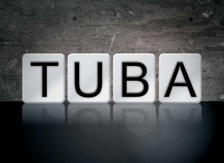 The word Tuba concept and theme written in white tiles on a dark background.