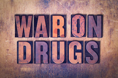 The words War on Drugs concept and theme written in vintage wooden letterpress type on a grunge background. Stok Fotoğraf