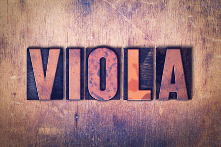 The word Viola concept and theme written in vintage wooden letterpress type on a grunge background.