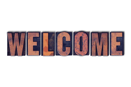 The word Welcome concept and theme written in vintage wooden letterpress type on a white background.