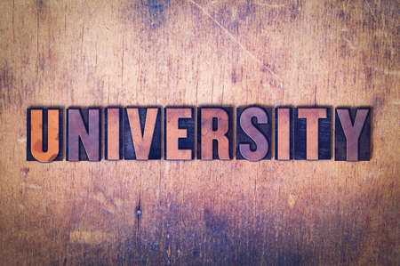The word University concept and theme written in vintage wooden letterpress type on a grunge background.