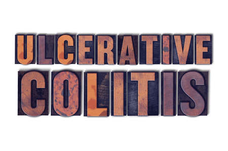 The words Ulcerative Colitis concept and theme written in vintage wooden letterpress type on a white background.
