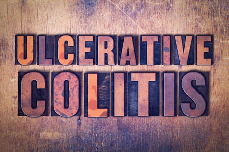 The words Ulcerative Colitis concept and theme written in vintage wooden letterpress type on a grunge background.