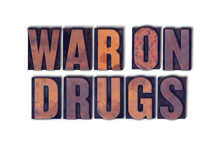 The words War on Drugs concept and theme written in vintage wooden letterpress type on a white background.