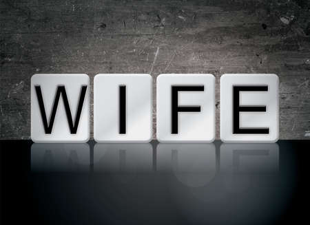 The word Wife concept and theme written in white tiles on a dark background. 写真素材