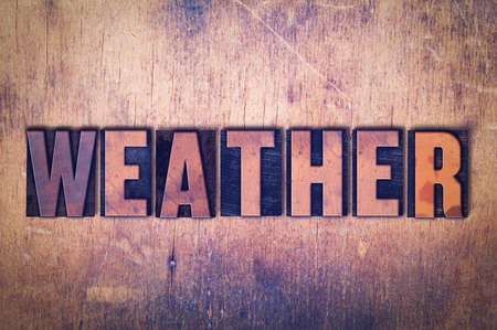 The word Weather concept and theme written in vintage wooden letterpress type on a grunge background.