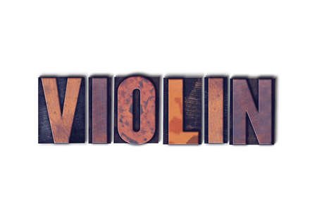 The word Violin concept and theme written in vintage wooden letterpress type on a white background.