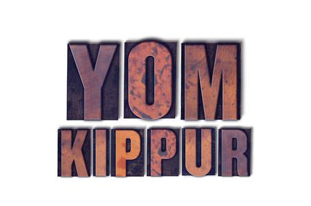 The words Yom Kippur concept and theme written in vintage wooden letterpress type on a white background. Archivio Fotografico