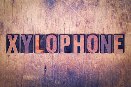 The word Xylophone concept and theme written in vintage wooden letterpress type on a grunge background.