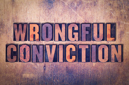 The words Wrongful Conviction concept and theme written in vintage wooden letterpress type on a grunge background.