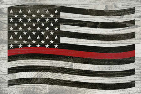 A firefighter flag with red stripe over a white washed wooden floor. 写真素材