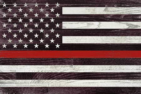 A firefighter support flag painted on white washed wood grained boards.