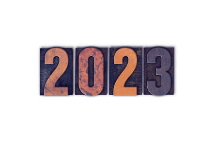 The year 2023 written in old vintage letterpress type isolated on a white background 免版税图像