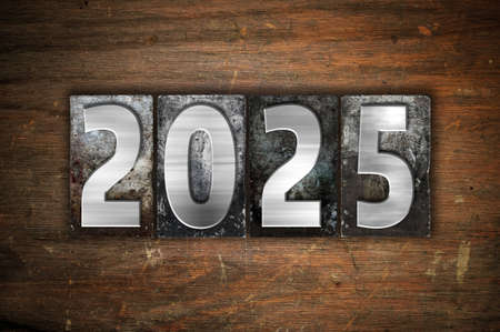 The year 2025 written in old vintage letterpress type.