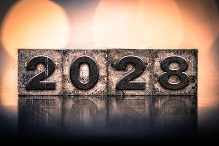 The year 2028 written in old vintage letterpress type. 免版税图像
